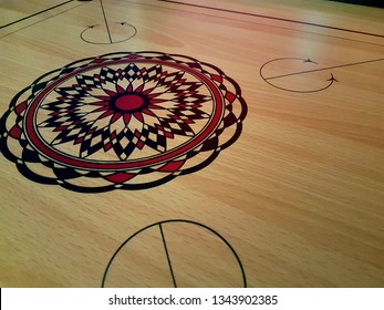 Carom board has no pin (gacuk). Just picture on it. The picture like compass or batic (batik).