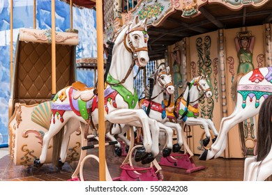 Carousel at a carnival or festival. Decorative ornate horse at a fun fair in Malaga, Spain