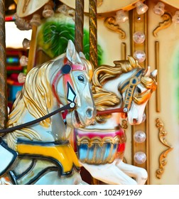 Carousel -  Fair conceptual background with horses