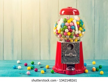 Carousel Gumball Machine Bank on a wooden background