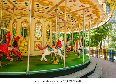 Carousel with horse. Amusement, fun in park. Fair entertainment. Carnival background. Ride, joy on holiday. Play on vintage old merry-go-round. Color attraction.