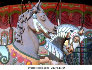 Carousel horses at a merry go round. This close up shows the old vintage horses heads.