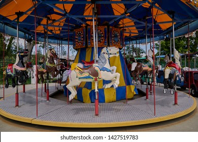 Carousel horses on a Merry Go Round at an amusement park