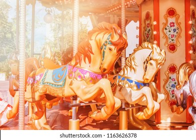 Carousel with horses on a sunny day