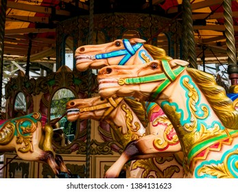 Carousel horses; traditional fairground carousel with galloping horses