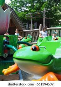 Carousel Jumping Frog. Attraction in Familypark, St. Margarethen, Burgenland, Austria, June 2017.