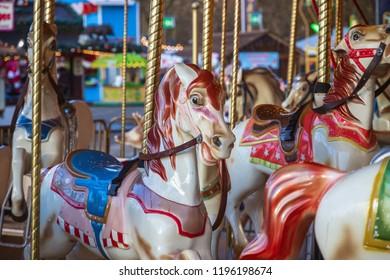 Carousel or merry-go-round at Christmas funfair winter wonderland, London