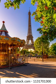 Carousel and Paris Eiffel tower on background in Paris, France. Eiffel Tower is one of the most iconic landmarks of Paris. Architecture and landmark of Paris.