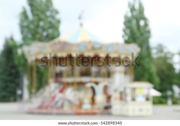 Carousel in the park, blurred background