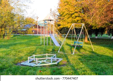 Carousel, swing and slide. Children playground. Swings and a slide to slide.