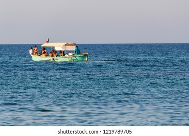 Carovigno/Brindisi, Italy - 08 08 2018: A group of tourists on a motor boat travels the sea during holidays in Puglia, in southern Italy.