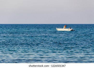 Carovigno/Brindisi, Italy - 08 08 2018: Man in a swimsuit on a motor boat in the Adriatic sea.