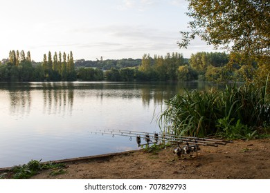 Carp Angling scenic landscape overlooking lake at Dawn