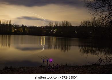 Carp Fishing Angling at lake at Night with illuminated Alarms