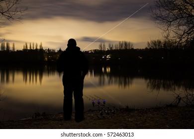 Carp Fishing Angling at Night with angler and illuminated Alarms