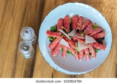 Carpaccio on the wooden table