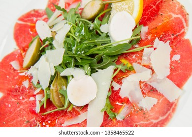 Carpaccio with rucola, goat cheese and parmesan cheese