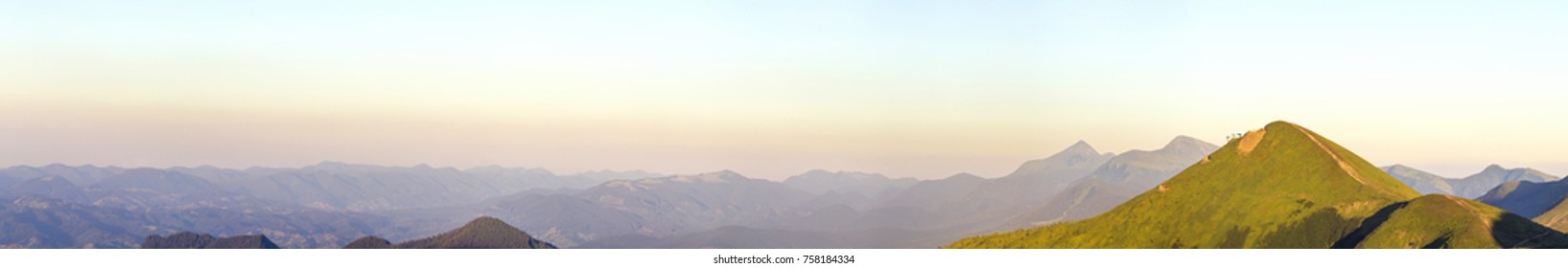 Carpathian mountain landscape in summer. Panoramic view. Sunset in Ukraine mountains. Wide panorama.