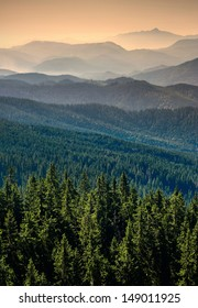 Carpathian mountain valley with many hills in a fog