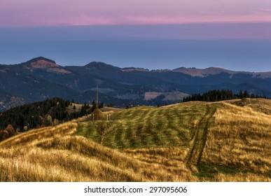 Carpathian Mountains. Autumn hills at sunset.