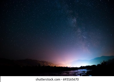 Carpathian mountains at night with spectacular night sky, Ukraine