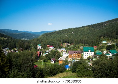 Carpathian mountains summer landscape with blue sky and clouds, natural background. Panoramic view