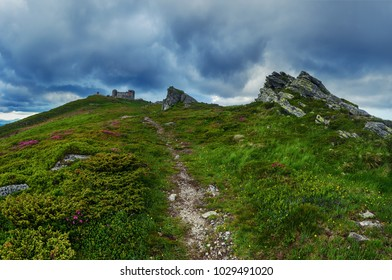 Carpathian mountains summer landscape with dramatic sky and old observatory on the top, natural travel background