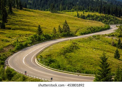Carpathians Mountains landscape. Romania. Beautiful winding road through the mountains