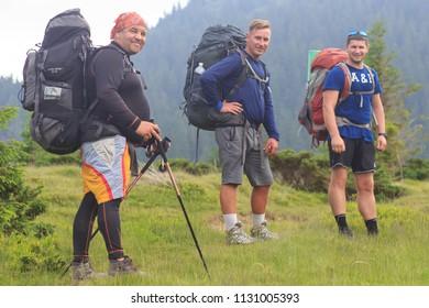 Carpathians. Ukraine. June 12, 2018. Group of hikers walking in mountains.