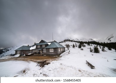 Carpathians. Ukraine. March 7, 2017;Wooden house in the snowy mountains. Wall and roof covering with natural shingle.