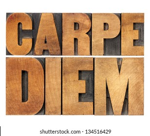 Carpe Diem  - enjoy life before it is too late, existential cautionary Latin phrase by Horace - isolated text in vintage letterpress wood type printing blocks, scaled to rectangle