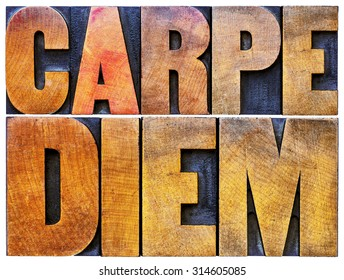 Carpe Diem  - enjoy life before it is too late, existential cautionary Latin phrase by Horace - isolated text in vintage letterpress wood type printing blocks stained by color inks