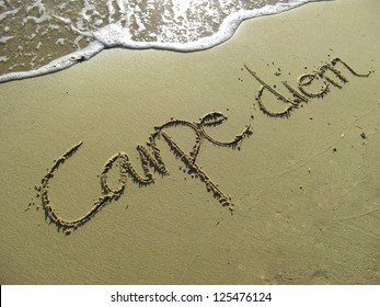 Carpe Diem Phrase in Sand on the Beach
