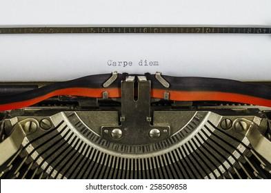 Carpe diem word printed on an old typewriter