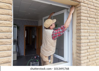 carpenter adjusting a new window