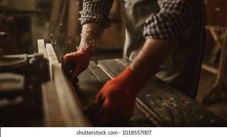 Carpenter craftsman working in a wood shop
