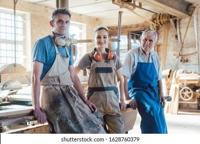 Carpenter family business with generations in the workshop having a break