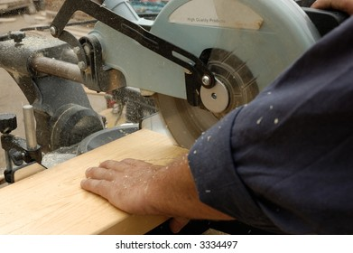 carpenter hand and  saw in time of  work