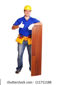 Carpenter holding the floor panel on white background showing thumbs up full length portrait