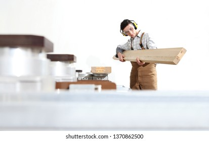 carpenter man works with wooden planks in the joinery, with computer numerical control center, cnc machine,  isolated on a white background