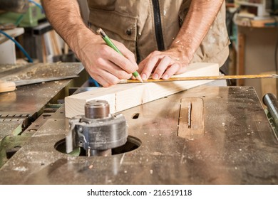 carpenter mark a wood plank