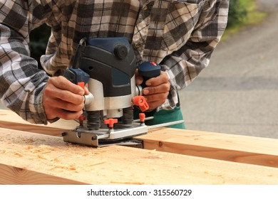 Carpenter milled wood upper hand electric router