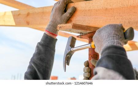 A carpenter on a construction site.