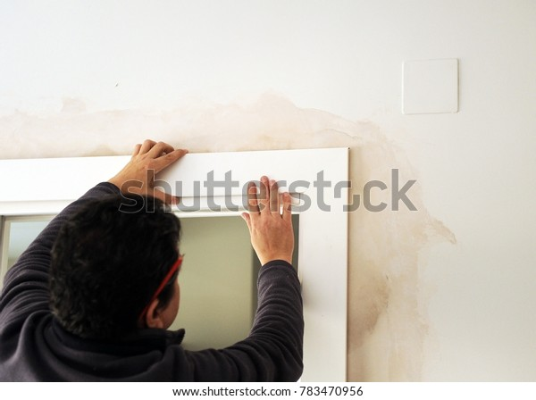 Carpenter placing the flashing of a white sliding door