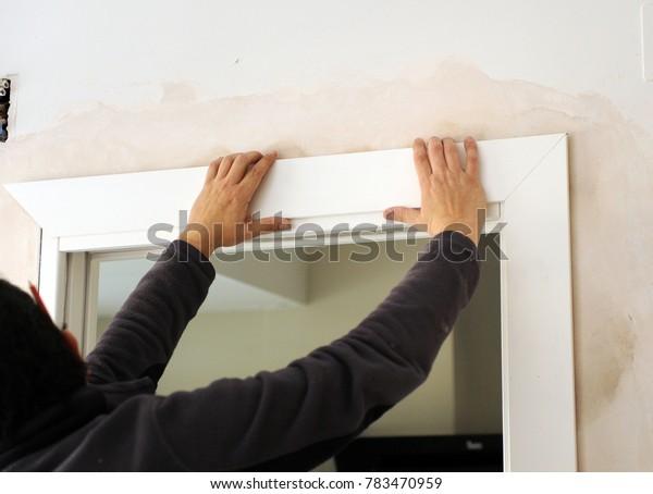 Carpenter placing the flashing of a white sliding door
