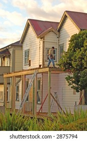 Carpenter renovating old two-storey house