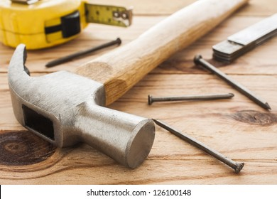 carpenter tools: hummer, tape measure, ruller and nails