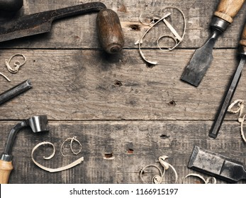 Carpenter tools on a rustic wooden background with space for text