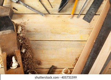 Carpenter tools on wood table background. Copy space. Top view.