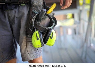 A Carpenter/ tradesman working on a job site with his tools.